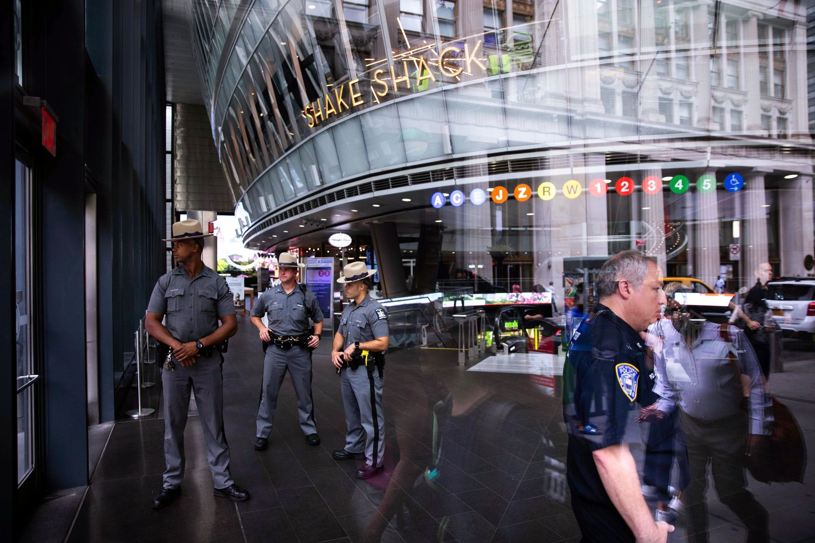 Law enforcement officers gather inside Fulton Street Station after suspicious device was reported Friday, August 16, 2019, in New York.{ } (AP Photo/Kevin Hagen).