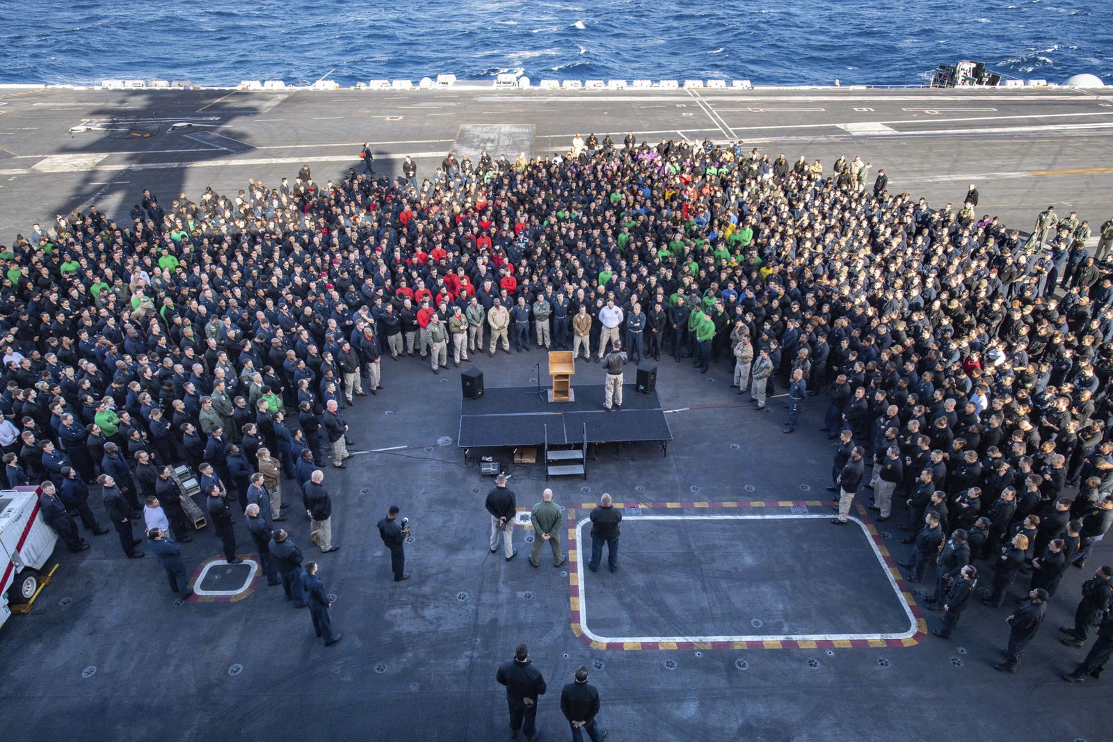 FILE - In this Dec. 15, 2019, file photo, U.S.Navy Capt. Brett Crozier, commanding officer of the aircraft carrier USS Theodore Roosevelt (CVN 71), addresses the crew during an all hands call on the ship's flight deck while conducting routine training in the Eastern Pacific Ocean. (U.S. Navy Photo by Mass Communication Specialist Seaman Kaylianna Genier via AP)