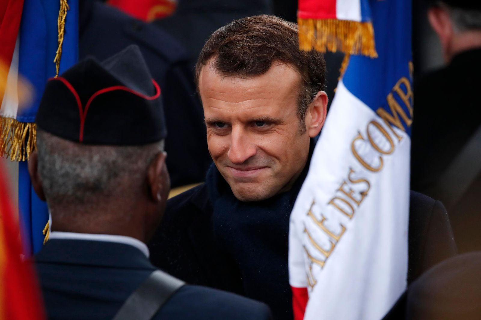 French President Emmanuel Macron meets veterans under the Arc de Triomphe during commemorations marking the 101st anniversary of the 1918 armistice, ending World War I, Monday Nov. 11, 2019 in Paris (AP Photo/Francois Mori, Pool)