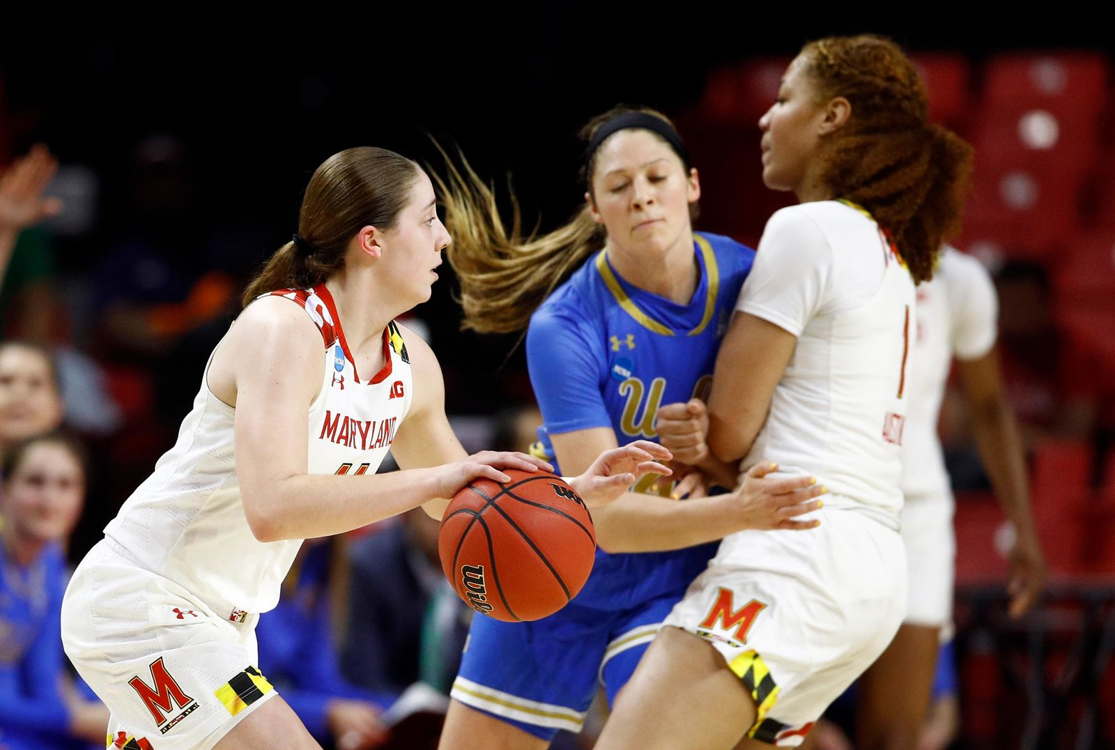 Maryland guard Taylor Mikesell, left, drives past UCLA guard Lindsey Corsaro as Corsaro is screened by Maryland forward Shakira Austin during the first half of a second-round game in the NCAA women's college basketball tournament, Monday, March 25, 2019, in College Park, Md. (AP Photo/Patrick Semansky)