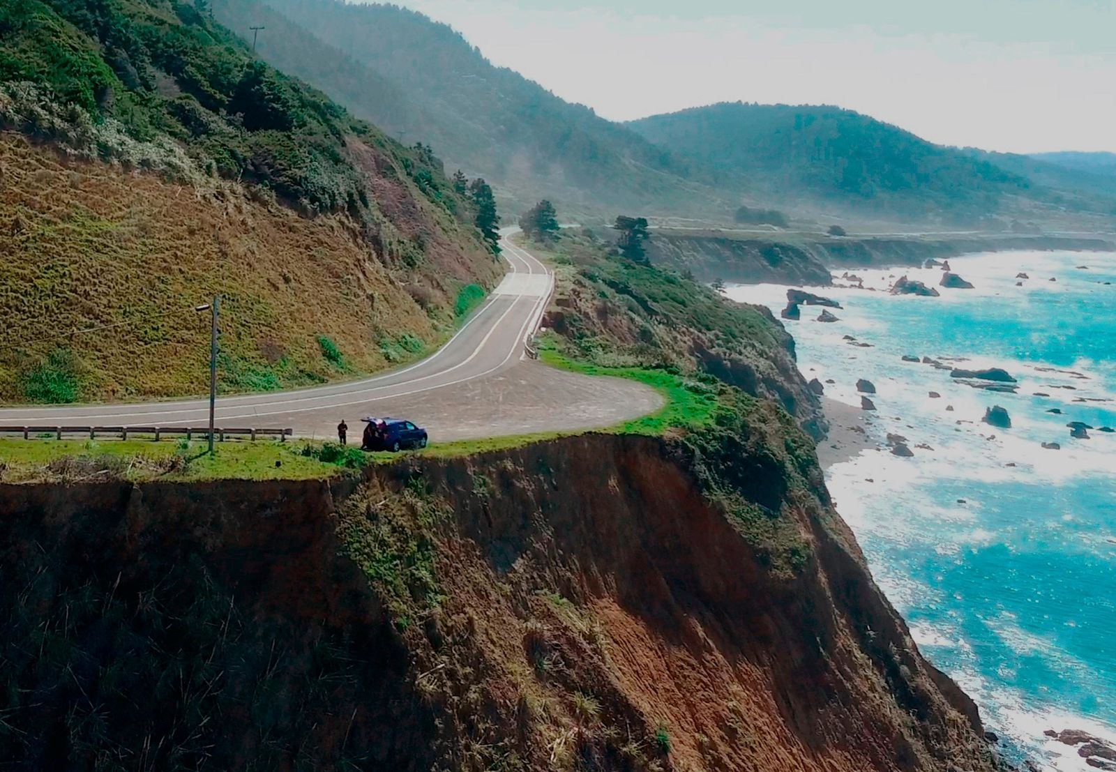 In this March 28, 2018 aerial file image from Alameda County Sheriff's Office drone video courtesy of Mendocino County shows the pullout where the SUV of Jennifer and Sarah Hart was recovered off the off Pacific Coast Highway 1, near Westport, Calif. The SUV carrying the large, free-spirited family from Washington state accelerated straight off the scenic California cliff and the deadly wreck may have been intentional, authorities said Sunday, April 1, 2018. (Alameda County Sheriff's Office via AP, File)