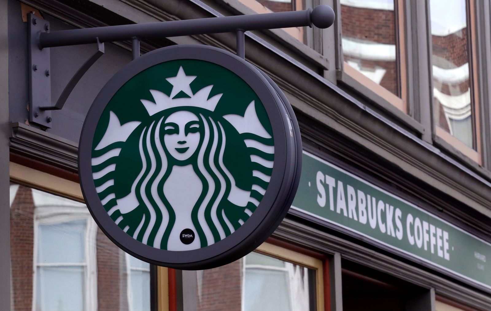 FILE- This Dec. 13, 2018, file photo shows a sign for a Starbucks Coffee shop in Harvard Square in Cambridge, Mass. Starbucks Corp. reports financial results Thursday, Jan. 24, 2019. (AP Photo/Charles Krupa, File)