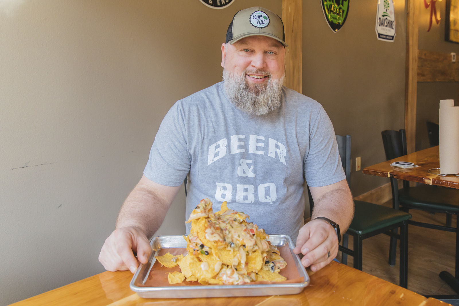 "<a  href=""https://hopsonthehillwa.com/"" target=""_blank"" title=""https://hopsonthehillwa.com/"">Hops on the Hill</a>{&nbsp;}in Tumwater is back open as of July 2, which means their famous Hill ""Can"" Nachos are yours for the taking once again! Topped with black bean corn pico, cheddar jack cheese, topped with queso and the option to add brisket, port & turkey or smoked carrot - you won't leave hungry. Hops on the Hill is a combo of ""craft beer meets Central Texas style BBQ"" and is open Tuesday thru Saturday, 12-9pm. (Image: Sunita Martini / Seattle Refined){&nbsp;}"