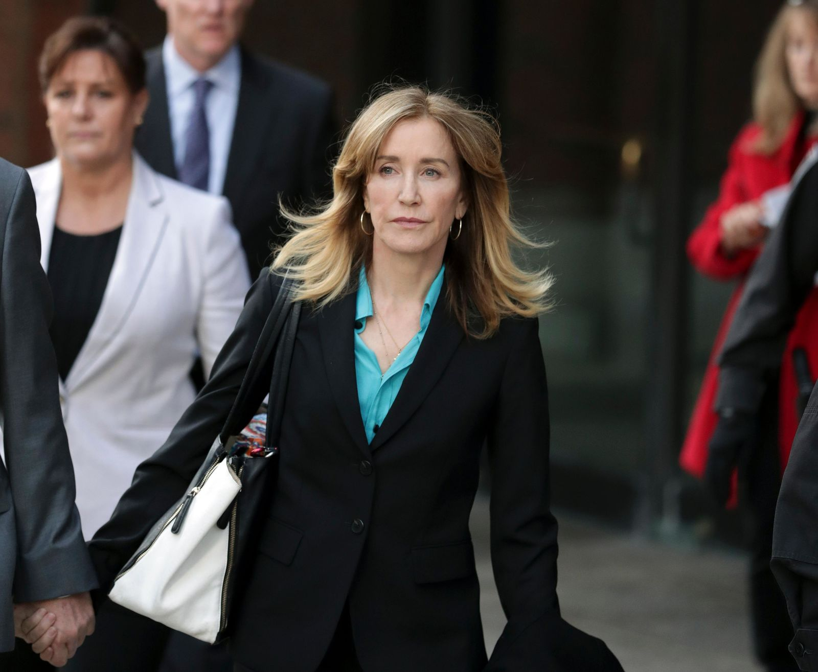 FILE - This April 3, 2019 file photo shows actress Felicity Huffman departing federal court in Boston after facing charges in a nationwide college admissions bribery scandal. (AP Photos/Charles Krupa, File)