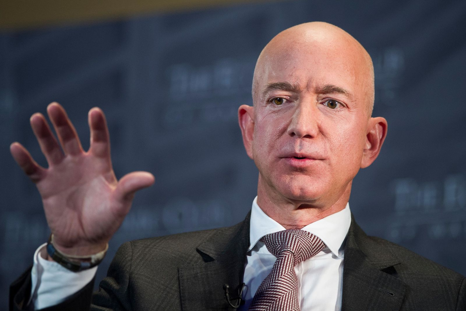 FILE- In this Sept. 13, 2018, file photo Jeff Bezos, Amazon founder and CEO, speaks at The Economic Club of Washington's Milestone Celebration in Washington.{ } (AP Photo/Cliff Owen, File)
