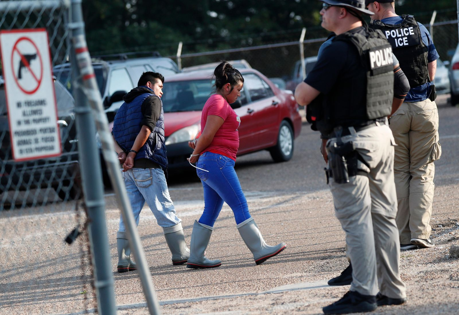Two people are taken into custody at a Koch Foods Inc. plant in Morton, Miss., on Wednesday, Aug. 7, 2019. (AP Photo/Rogelio V. Solis)