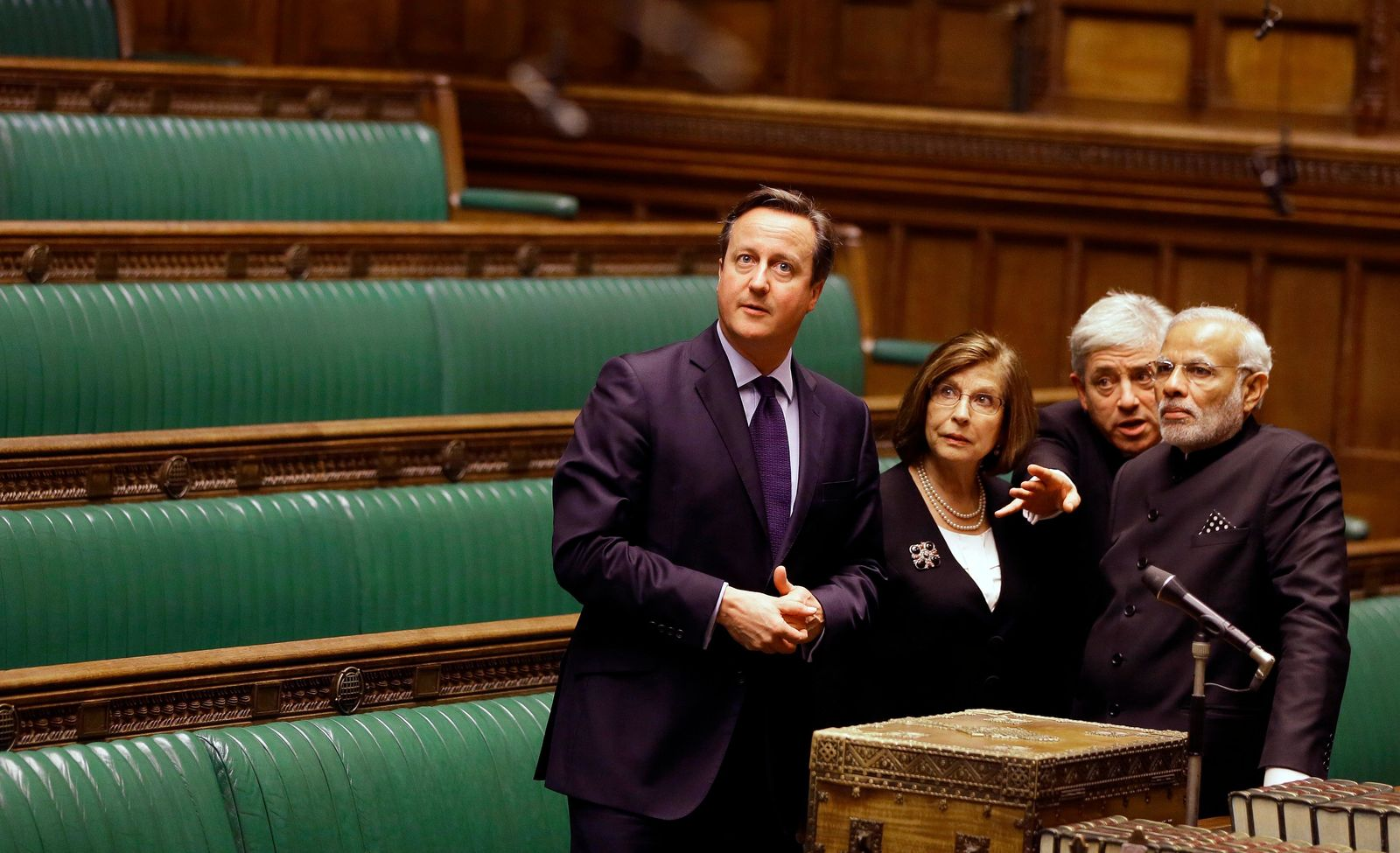 FILE - In this Thursday, Nov. 12, 2015 file photo, Britain's Prime Minister David Cameron, left, with India's Prime Minister Narendra Modi, right, John Bercow, the Speaker of the House of Commons, second right, and Baroness D'Souza, second left, in the chamber as they tour Parliament in London. A colorful era in British parliamentary history is coming to a close with Speaker of the House John Bercow's abrupt announcement Monday, Sept. 9, 2019 that he will leave his influential post by the end of October.  (AP Photo/Kirsty Wigglesworth, pool)