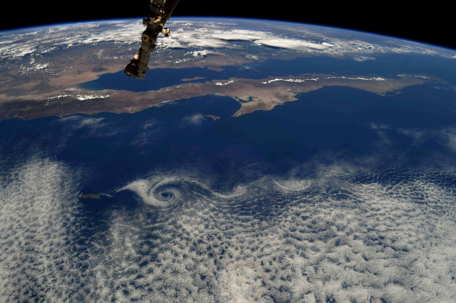 Vortices trail behind Isla Guadalupe near Baja #Mexico #California. (Photo & Caption Ricky Arnold, NASA)
