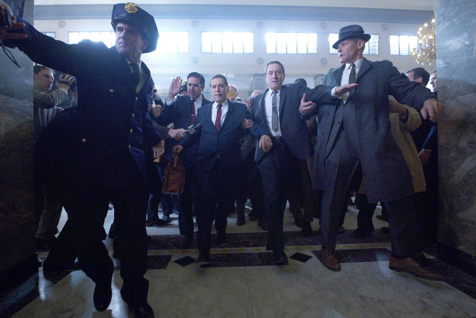 "This image released by Netflix shows Al Pacino, center left, and Robert De Niro, center right, in a scene from ""The Irishman."" (Netflix via AP)"