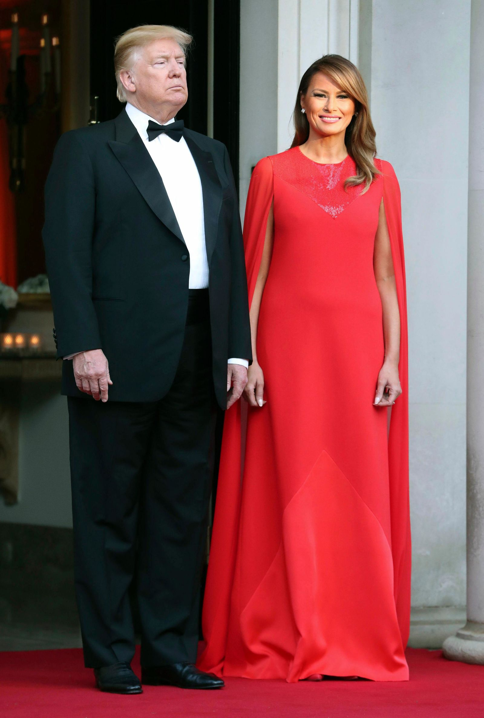 US President Donald Trump and first lady Melania Trump wait to greet Britain's Prince Charles and Camilla, the Duchess of Cornwall, outside Winfield House, the residence of the Ambassador of the United States of America to the UK, in Regent's Park, prior to the Return Dinner as part of his state visit to the UK, in London, Tuesday June 4, 2019. (Chris Jackson/Pool Photo via AP)