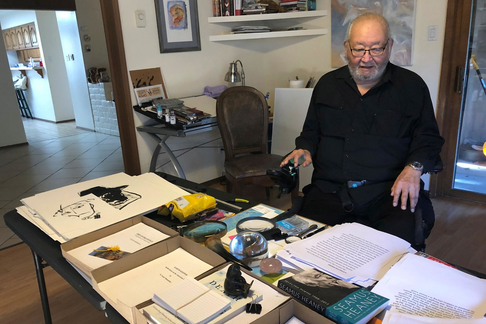 "In this Wednesday, Nov. 13, 2019, photo, Kiowa writer N. Scott Momaday, who won a Pulitzer Prize in 1969 for his groundbreaking novel ""House Made of Dawn,"" sits in his Santa Fe, N.M., home between writing sessions. In a rare interview with The Associated Press, the 85-year-old Native American author says he's excited about a new PBS American Masters documentary about his life. But he remains surprised and humbled that other writers have said his work has influenced them. (AP Photo/Russell Contreras)"