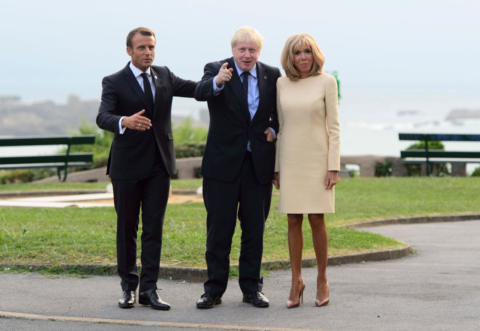 Britian's Prime Minister Boris Johnson, center, is greeted by President of France Emmanuel Macron, left, and wife Brigitte Macron as he arrives to the G7 Summit in Biarritz, France, Saturday, Aug. 24, 2019. (Sean Kilpatrick/The Canadian Press via AP)