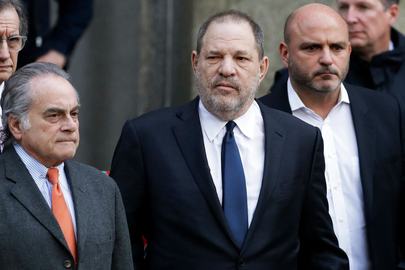 FILE - In this Thursday, Dec. 20, 2018, file photo, Harvey Weinstein, center, leaves New York Supreme Court with his attorney Benjamin Brafman, left, in New York. (AP Photo/Mark Lennihan, File)