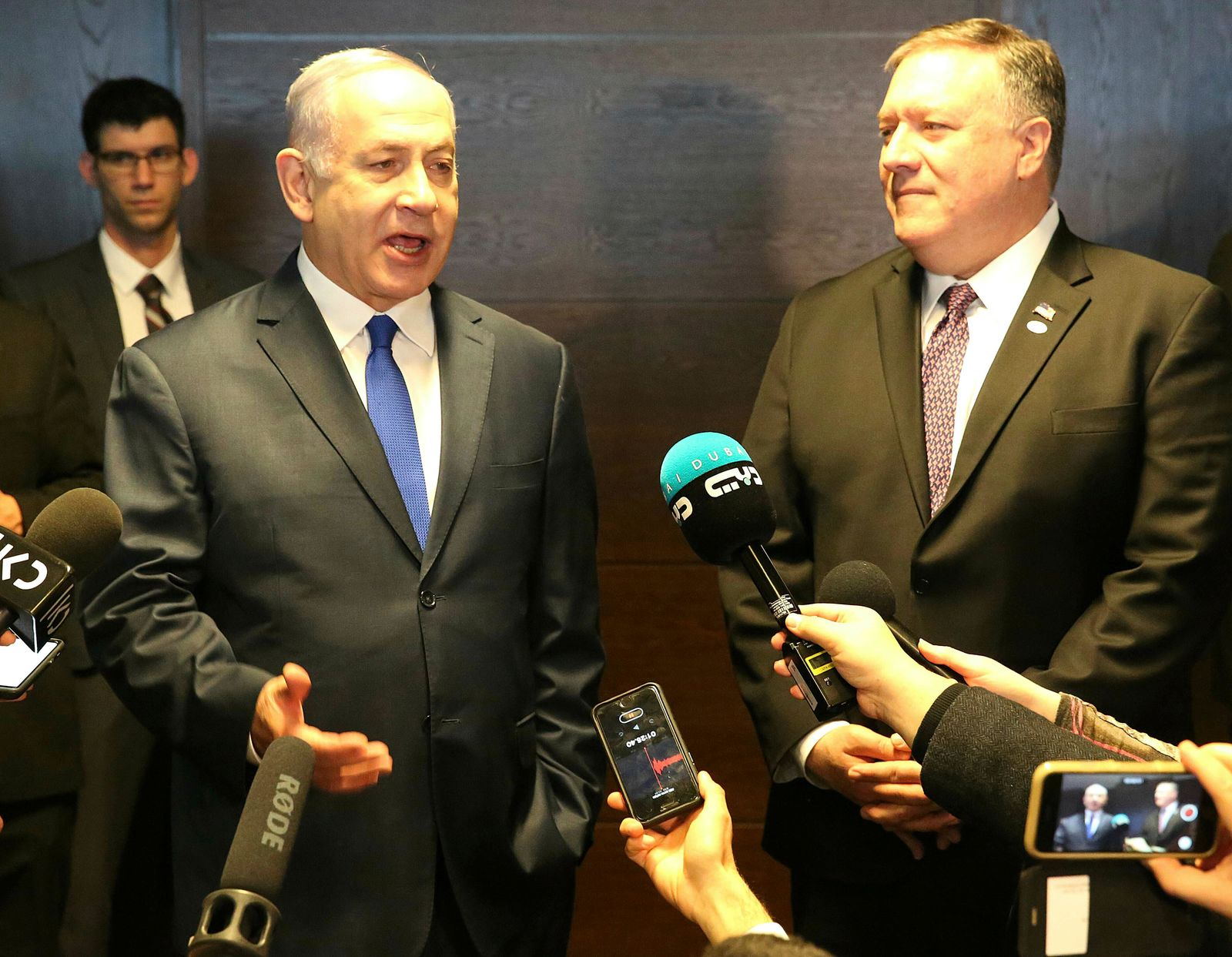 Israeli Prime Minister Benjamin Netanyahu, left, and US Secretary of State Mike Pompeo, right, talk to the press on the sidelines of a session at the conference on Peace and Security in the Middle East in Warsaw, Poland, Thursday, Feb. 14, 2019. (AP Photo/Czarek Sokolowski)