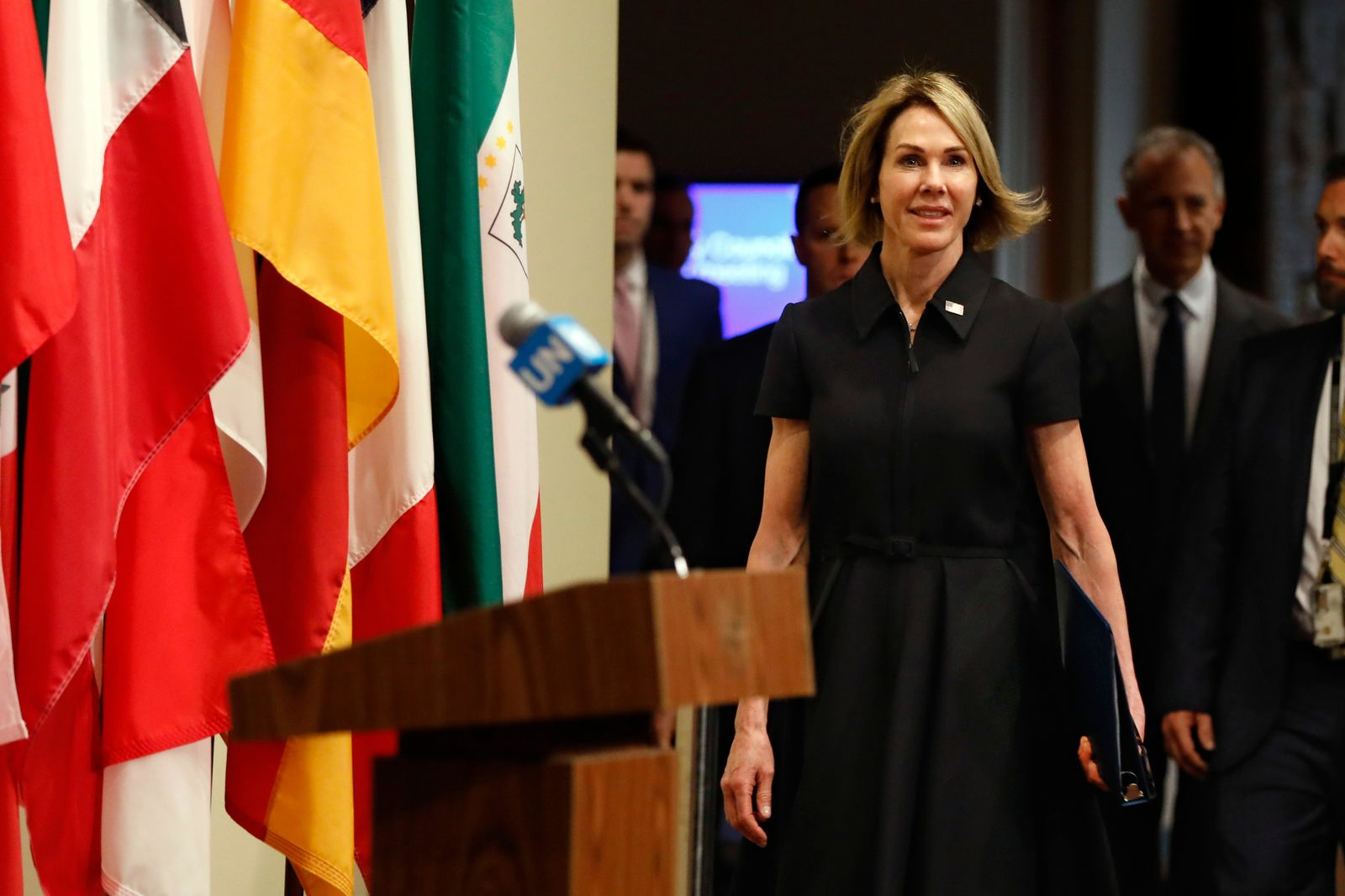 New U.S. Ambassador Kelly Craft walks to the podium to address the press after attending her first Security Council meeting, at United Nations headquarters, Thursday, Sept. 12, 2019. (AP Photo/Richard Drew)