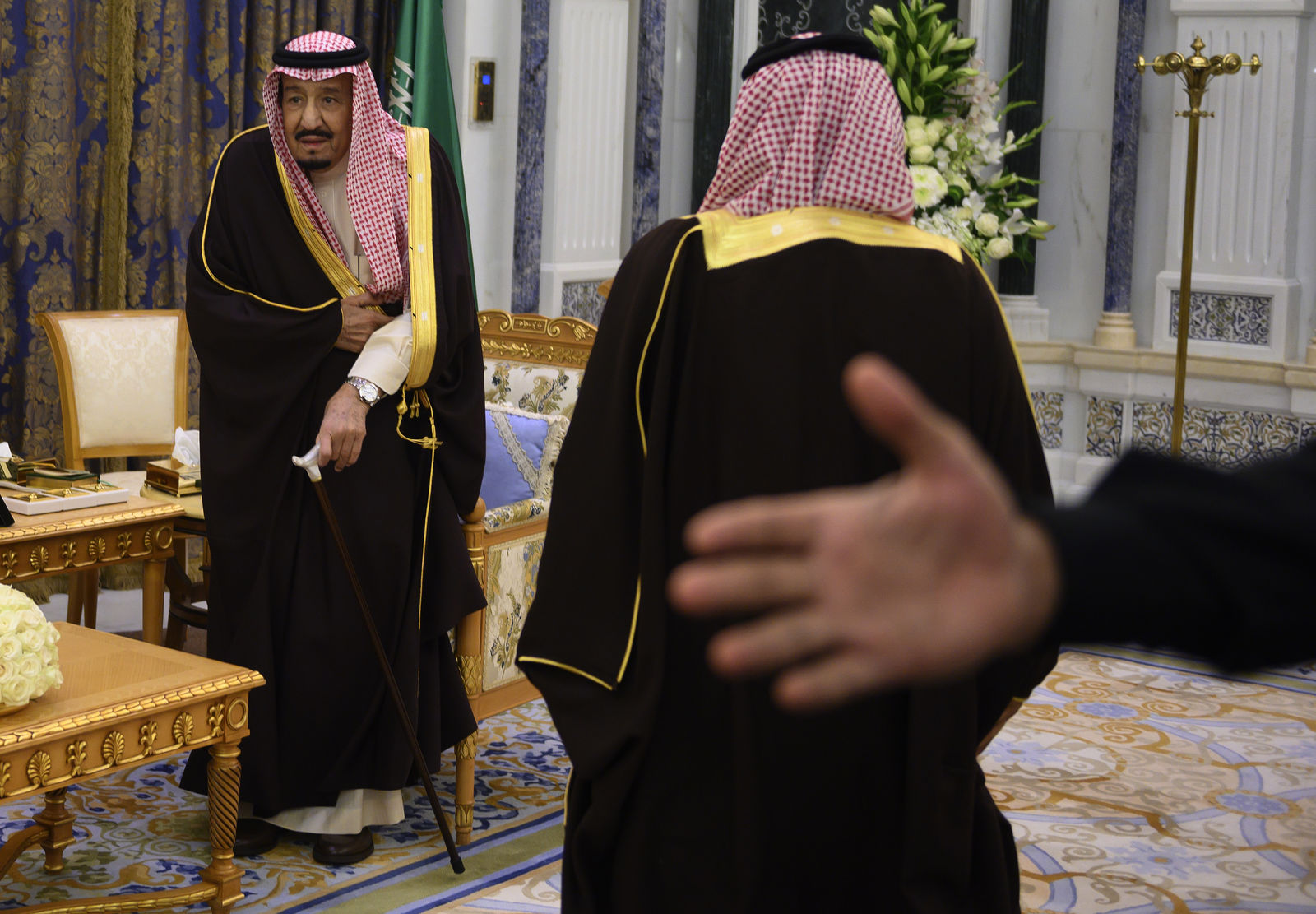 Saudi Arabia's King Salman, left, stands to greet U.S. Secretary of State Mike Pompeo at the Royal Court in Riyadh, Monday, January 14, 2019. (Andrew Cabellero-Reynolds/Pool via AP)
