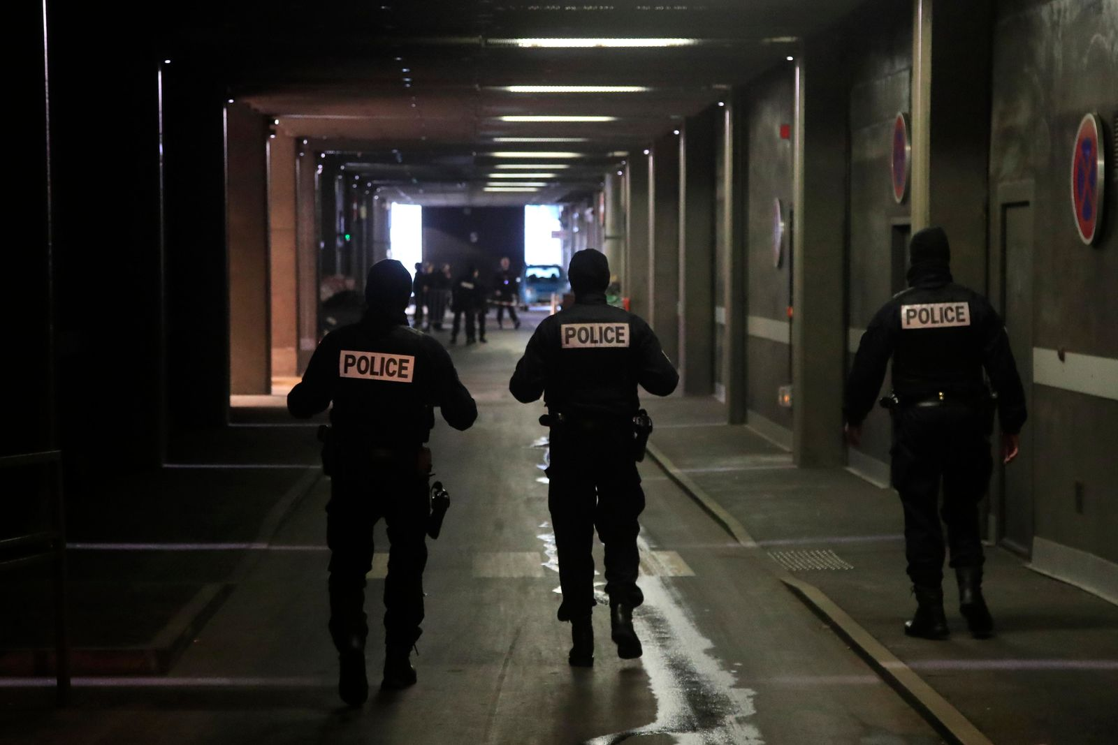 Police officers patrol in a tunnel under Le Defense business district after a man who threatened officers Friday, Dec.13, 2019 in Paris. (AP Photo/Michel Euler)