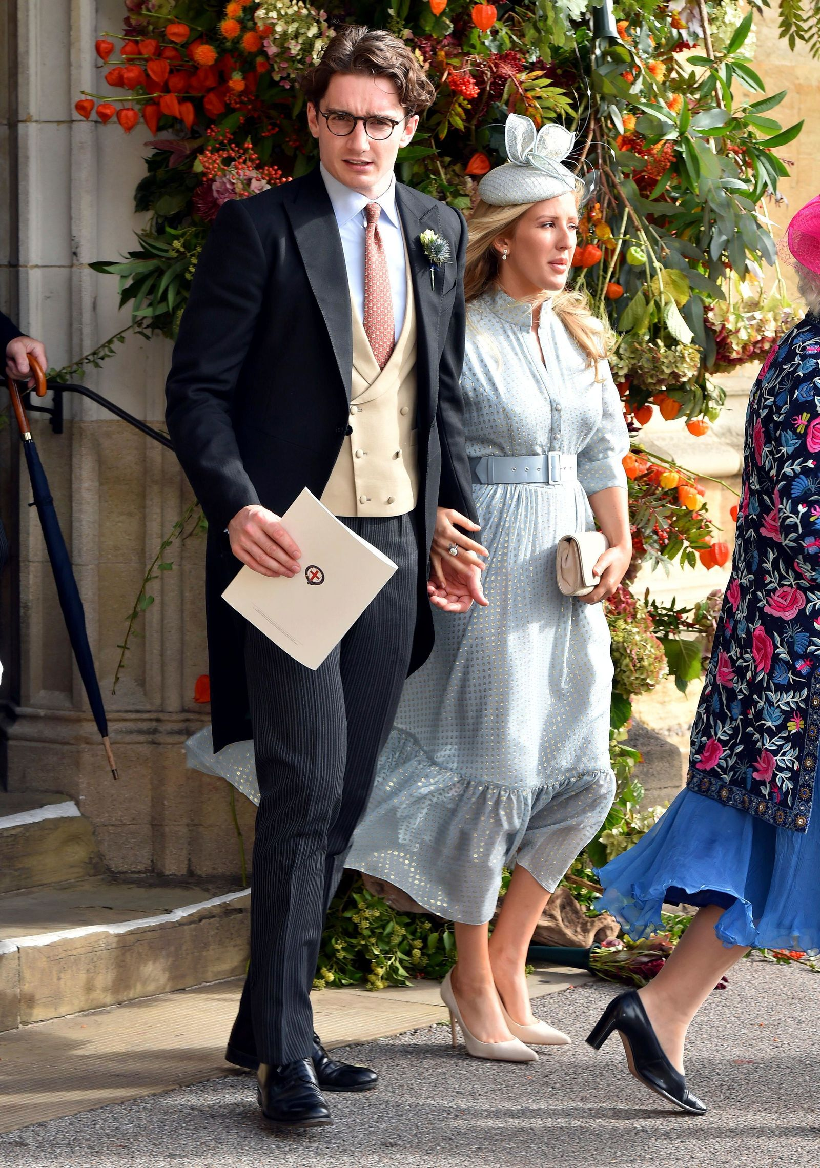 FILE - In this Oct. 12, 2018 file photo,  Caspar Joplin, left, and singer Ellie Goulding depart after the wedding of Princess Eugenie of York and Jack Brooksbank at St George's Chapel, Windsor Castle, near London, England. (Matt Crossick, Pool via AP, File)