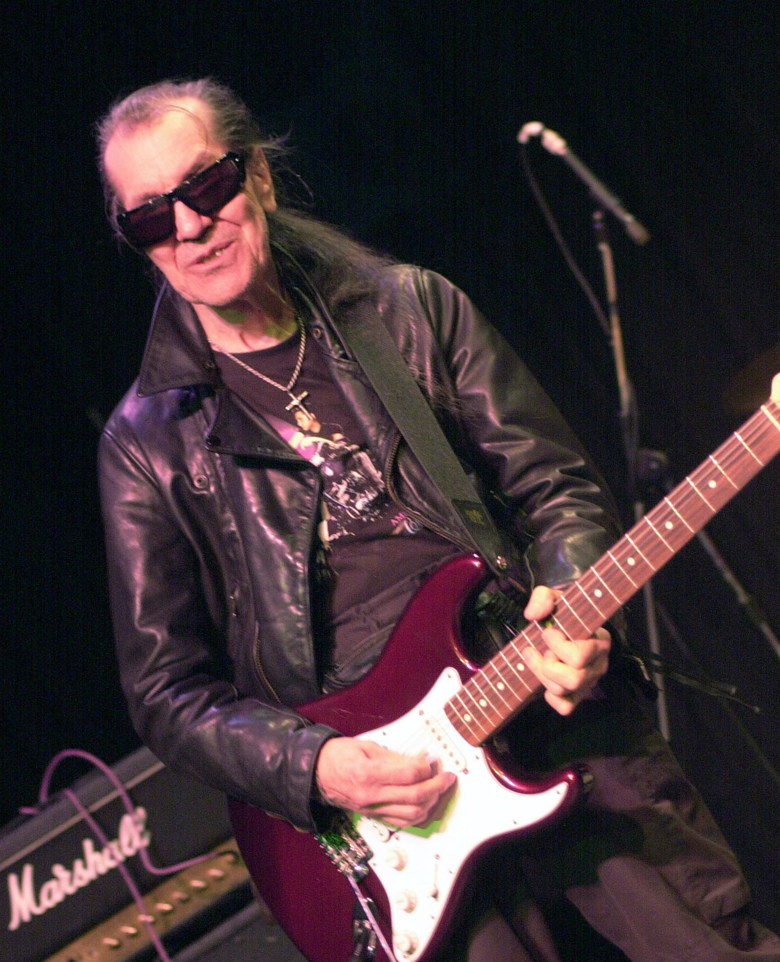 "FILE - In this July 21, 2002 file photo, Link Wray, the 73-year-old Shawnee Indian and acclaimed pioneer of punk and heavy metal, performs at the Shim Sham Club in New Orleans. ""RUMBLE: The Indians Who Rocked the World,"" a new PBS Independent Lens documentary set to air Monday, Jan 21, 2019, shows how Native Americans laid the foundations to rock, blues and jazz. (AP Photo/Cheryl Gerber, File)"
