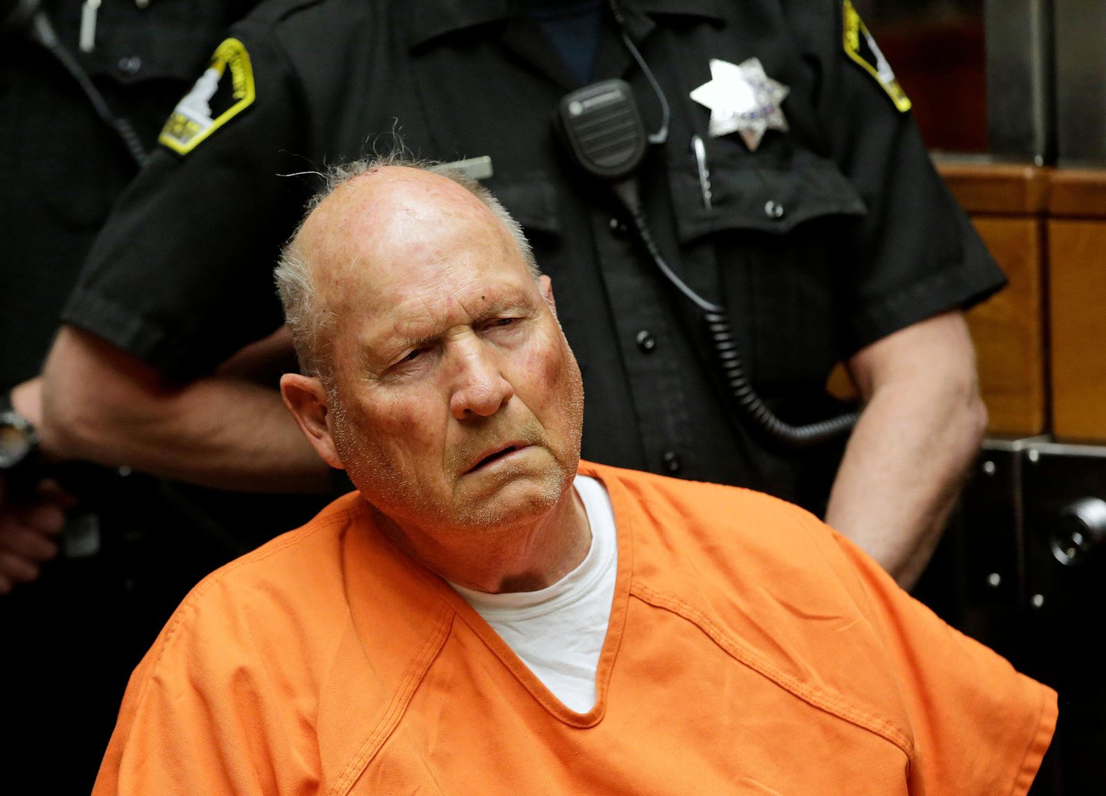 FILE - In this April 27, 2018 file photo Joseph James DeAngelo, 72, who authorities suspect is the so-called Golden State Killer responsible for at least a dozen murders and 50 rapes in the 1970s and 80s, is arraigned in Sacramento County Superior Court in Sacramento, Calif. (AP Photo/Rich Pedroncelli, File)