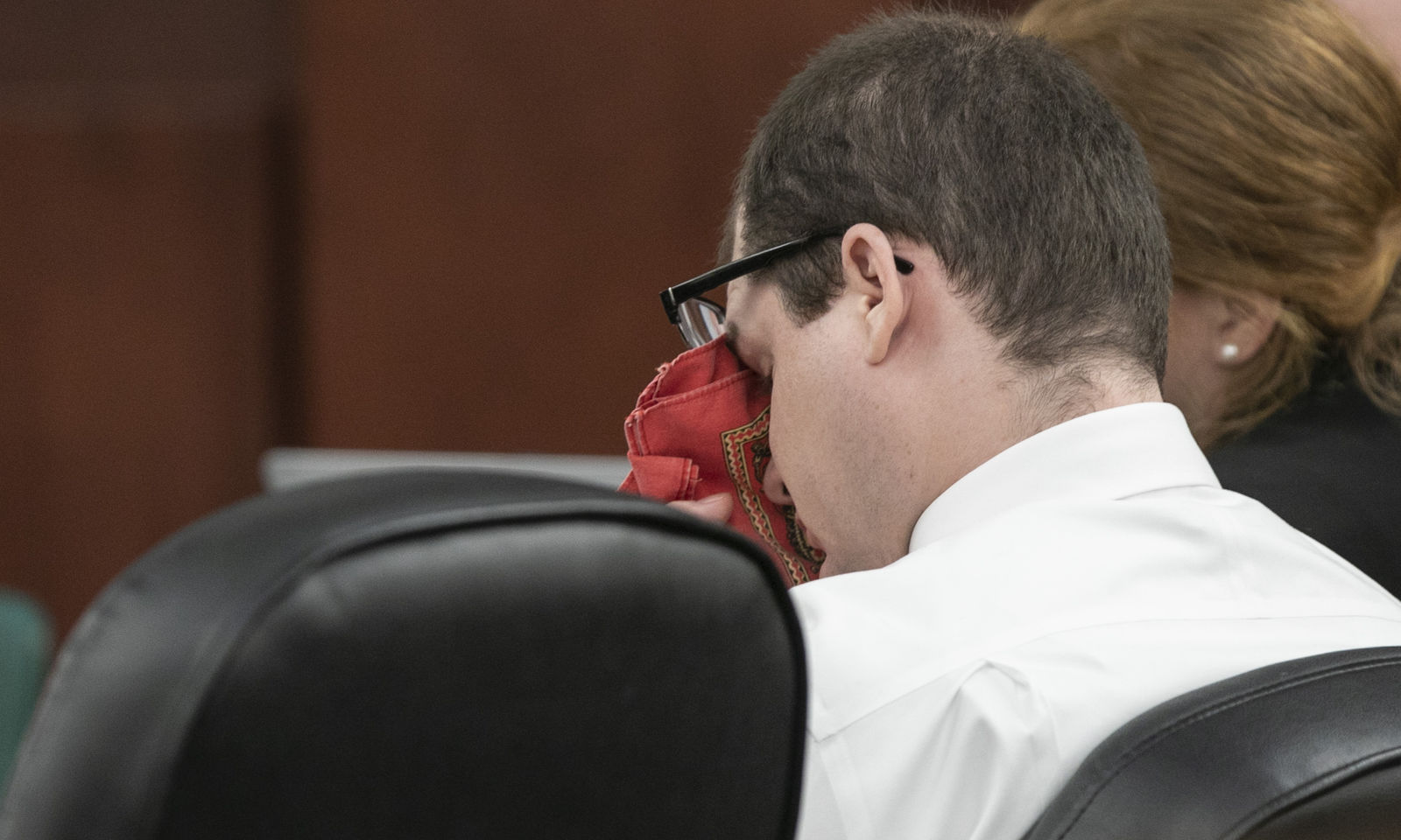 Timothy Jones Jr. wipes his eyes as his ex-wife Amber Kyzer, mother of five children who were killed by their father, Jones, during the sentencing phase of Jones' trial in Lexington, S.C., Tuesday, June 11, 2019. (Tracy Glantz/The State via AP, Pool)