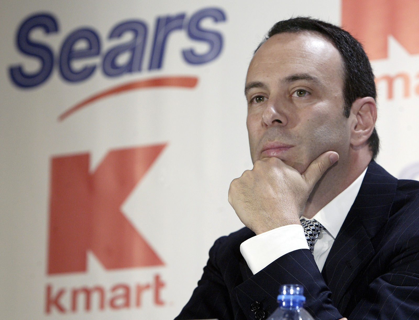 FILE- In this Nov. 17, 2004, file photo Kmart chairman Edward Lampert listens during a news conference to announce the merger of Kmart and Sears in New York. (AP Photo/Gregory Bull, File)