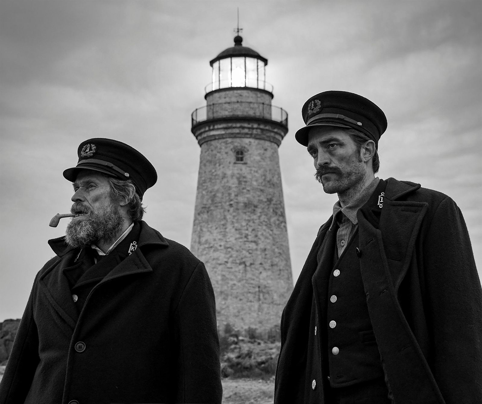 "This image released by A24 Films shows Willem Dafoe, left, and Robert Pattinson in a scene from ""The Lighthouse."" The Safdie brothers' Diamond District crime film ""Uncut Gems"" and Robert Eggers' fever-dream period tale ""The Lighthouse"" lead the 35th annual Film Independent Spirit Awards with five nominations each. The Spirit Awards will be held Feb. 8, the day before the Academy Awards. (Eric Chakeen/A24 Pictures via AP)"