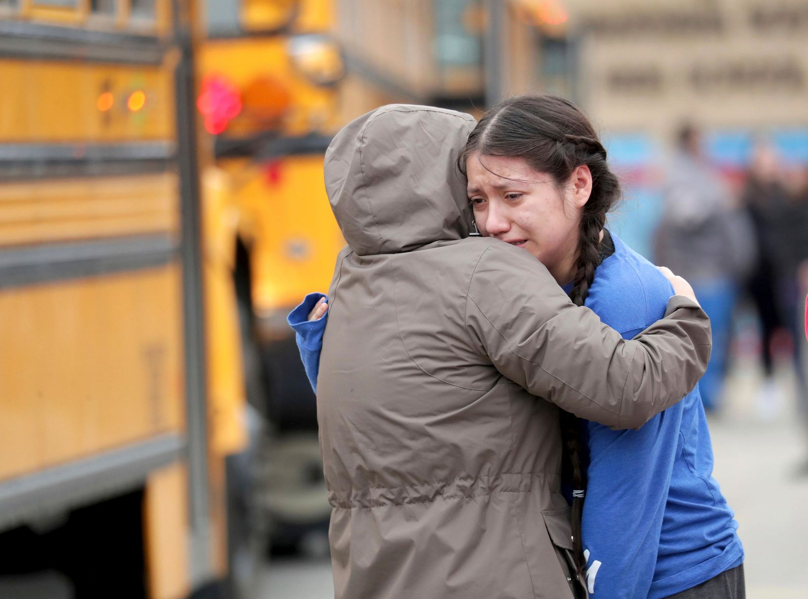 Gabriela Mauricio, right, a 14-year-old freshman, hugs her mother Meche Mauricio, after the two were reunited outside Waukesha South High School in Waukesha on Monday, Dec. 2, 2019. (Mike De Sisti/Milwaukee Journal-Sentinel via AP)