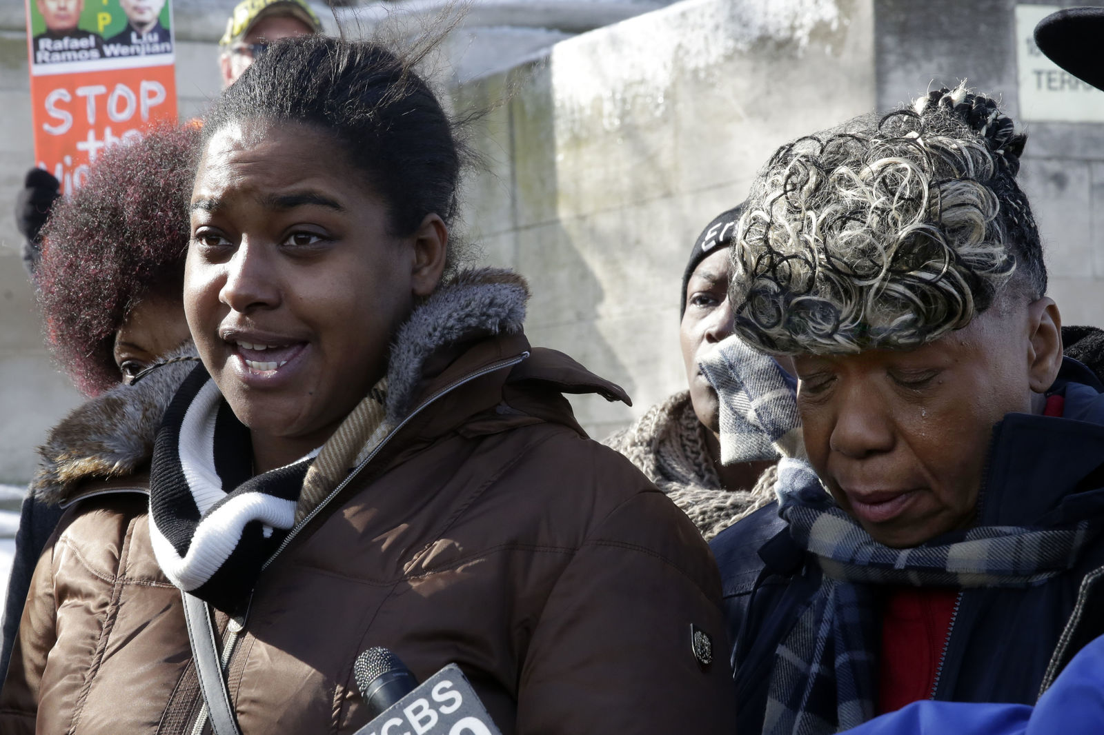 Erica Garner, left, daughter of chokehold death victim Eric Garner, and his mother Gwen Carr, talk to the press after attending a court hearing, in the Staten Island borough of New York, Thursday, Feb. 5, 2015. (AP Photo/Richard Drew)