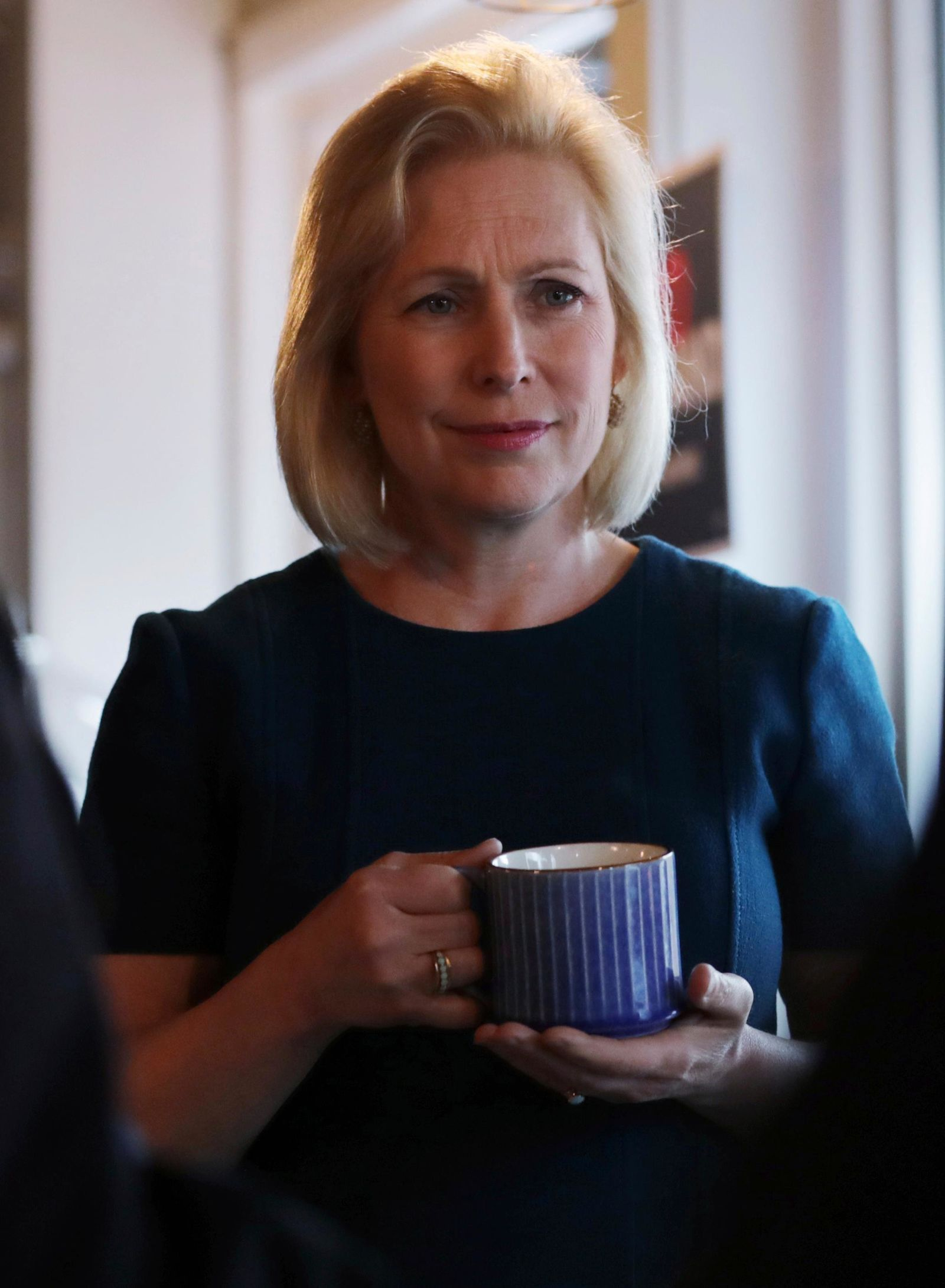 Democratic presidential candidate Sen. Kirsten Gillibrand, D-N.Y., listens to a question during a campaign stop at a coffee shop in Derry, N.H., Friday, May 10, 2019. (AP Photo/Charles Krupa)