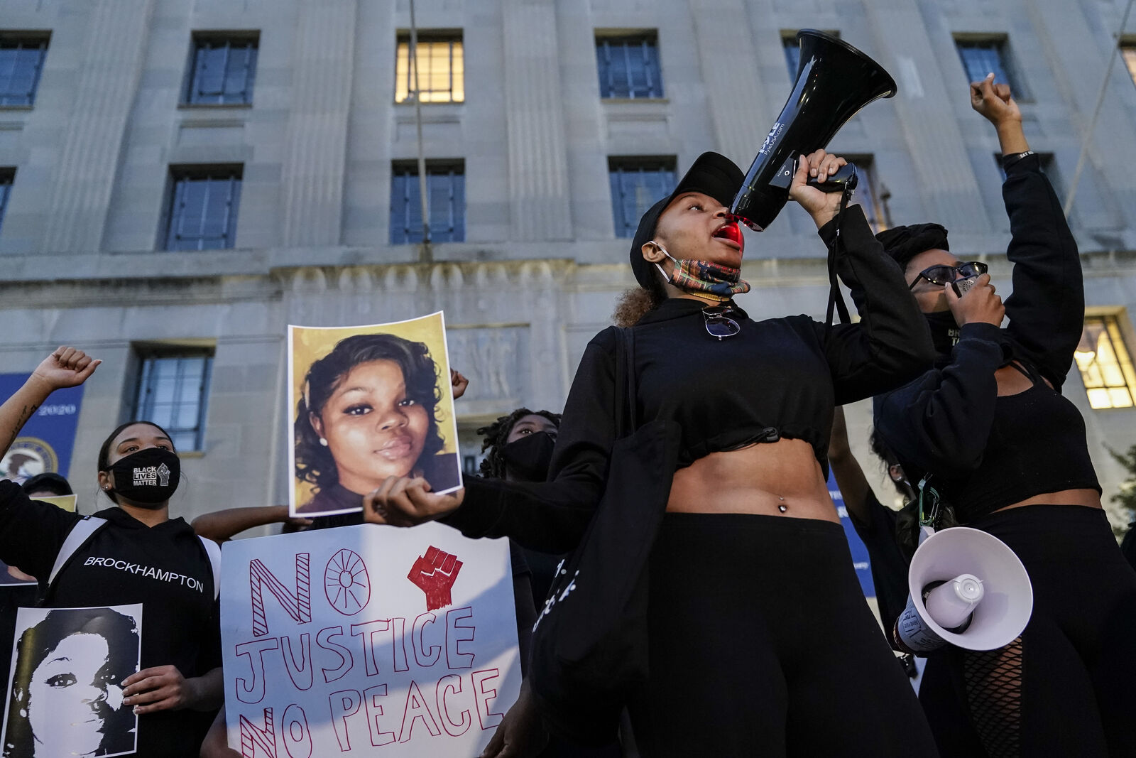 WASHINGTON, DC - SEPTEMBER 23: Demonstrators rally in front of the U.S. Department of Justice in protest following a Kentucky grand jury decision in the Breonna Taylor case on September 23, 2020 in Washington, DC. A Kentucky grand jury indicted one police officer involved in the shooting of Breonna Taylor with 3 counts of wanton endangerment. No officers were indicted on charges in connection to Taylor's death. (Photo by Drew Angerer/Getty Images)