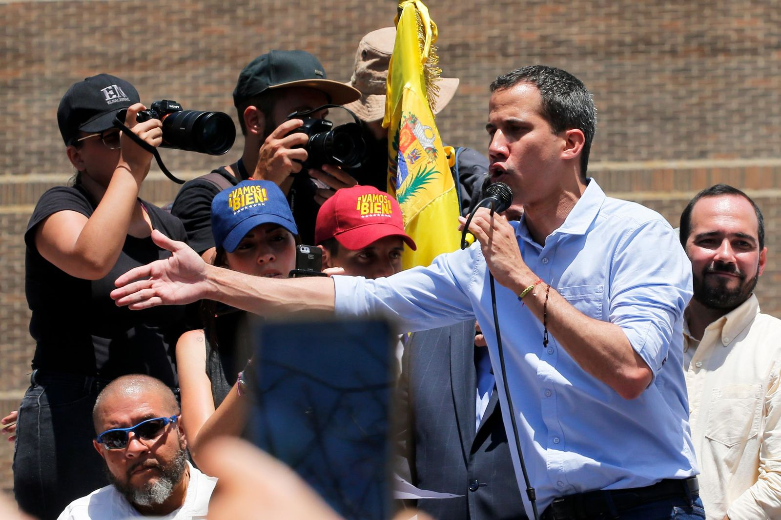 Opposition leader and self-proclaimed interim president Juan Guaido speaks to supporters during a rally to protest outages that left most of the country scrambling for days in the dark in Caracas, Venezuela, Saturday, April 6, 2019. (AP Photo/Fernando Llano)