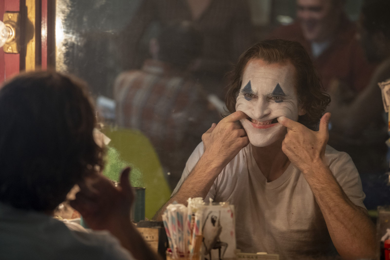 "This image released by Warner Bros. Pictures shows Joaquin Phoenix in a scene from the film ""Joker."" (Niko Tavernise/Warner Bros. Pictures via AP)"