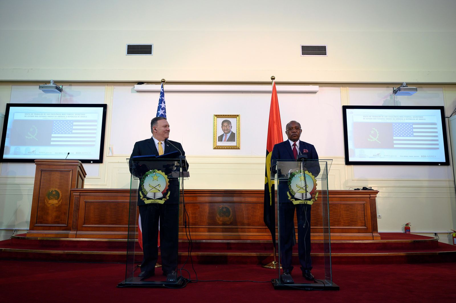 US Secretary of State, Mike Pompeo, left, and Angola Foreign Minister, Manuel Domingos Augusto hold a press conference in Luanda, Angola, Monday Feb. 17, 2020. (Andrew Caballero-Reynolds/Pool via AP)