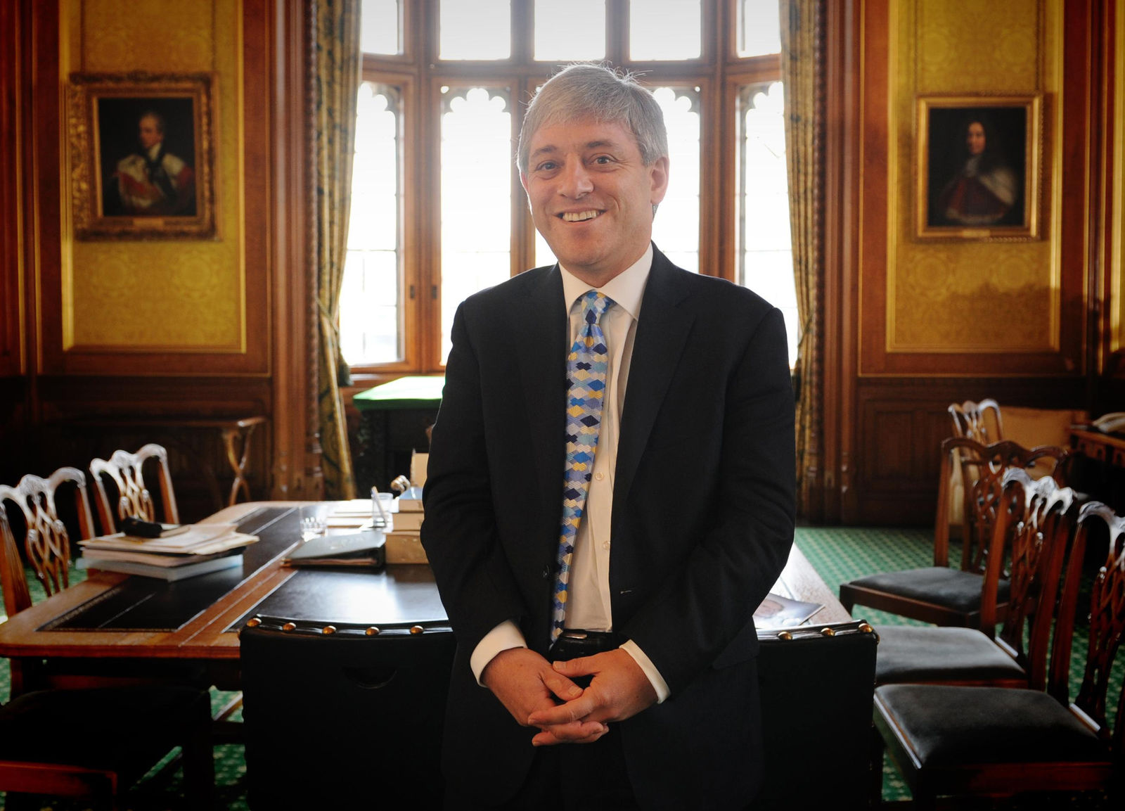 FILE - In this Tuesday June 23, 2009 file photo, the new Speaker of the British House of Commons, John Bercow, is seen at his office, at the House of Commons in Westminster, London, one day after he was appointed to the position. A colorful era in British parliamentary history is coming to a close with Speaker of the House John Bercow's abrupt announcement Monday, Sept. 9, 2019 that he will leave his influential post by the end of October. (AP Photo/Stefan Rousseau, file)