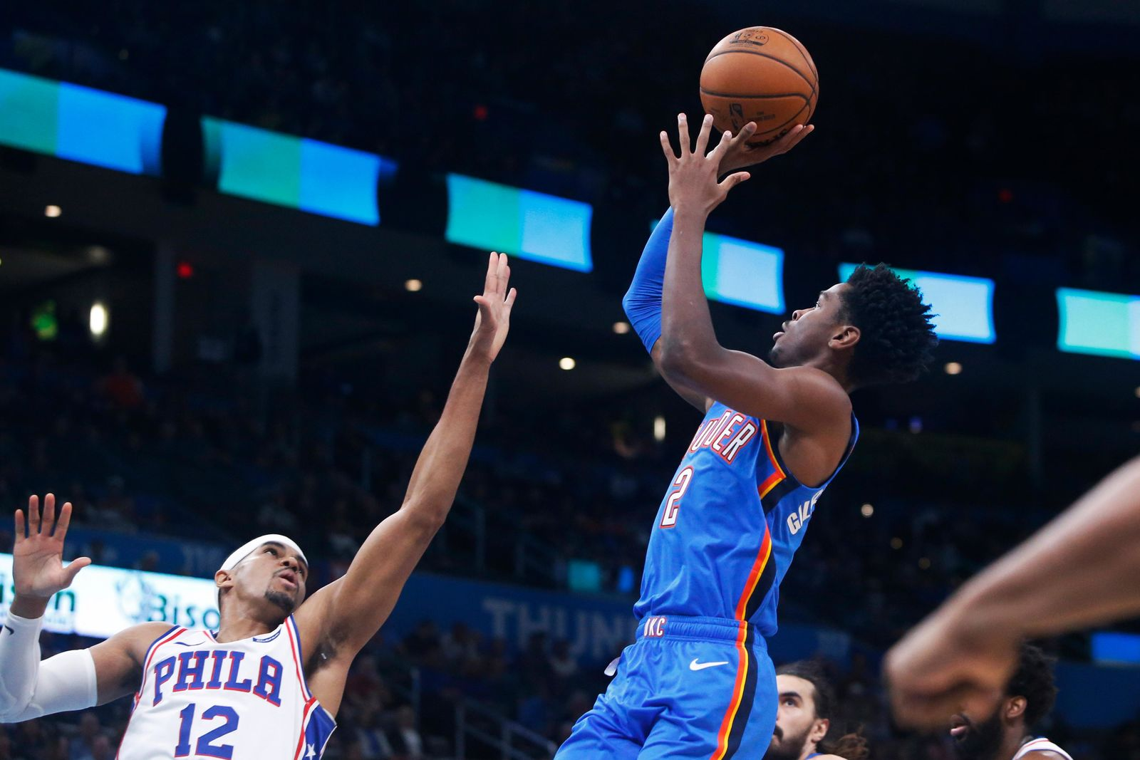 Oklahoma City Thunder guard Shai Gilgeous-Alexander (2) shoots over Philadelphia 76ers forward Tobias Harris (12) during the first half of an NBA basketball game Friday, Nov. 15, 2019, in Oklahoma City. (AP Photo/Sue Ogrocki)