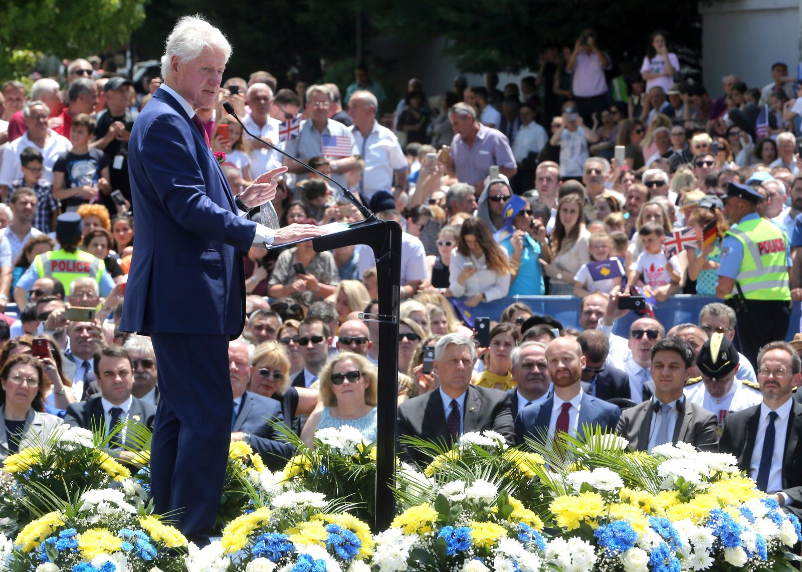 Former U.S. President Bill Clinton speaks during anniversary celebrations in the capital Pristina, Kosovo, Wednesday, June 12, 2019. It's exactly 20 years since NATO forces set foot in the former Yugoslav province, after an allied bombing campaign ended Serbia's bloody crackdown on an insurrection by the majority ethnic Albanian population in Kosovo _ revered by Serbs as their historic and religious heartland. (AP Photo/Visar Kryeziu)