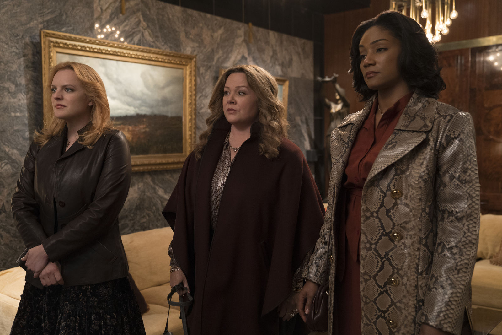 "(L-R) ELISABETH MOSS as Claire, MELISSA McCARTHY as Kathy and TIFFANY HADDISH as Ruby in New Line Cinema's mob drama ""The Kitchen,"" a Warner Bros. Pictures release. (Photo: Warner Bros.)"