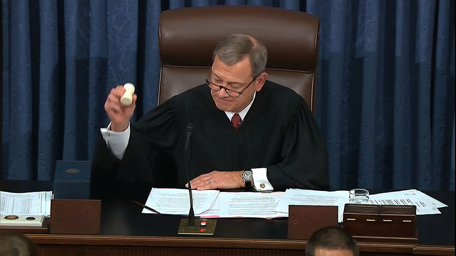 In this image from video, presiding officer Chief Justice of the United States John Roberts gavels the impeachment trial against President Donald Trump to an end in the Senate at the U.S. Capitol in Washington, Wednesday, Feb. 5, 2020. The U.S. Senate has acquitted Trump, ending only the third presidential trial in American history. (Senate Television via AP)