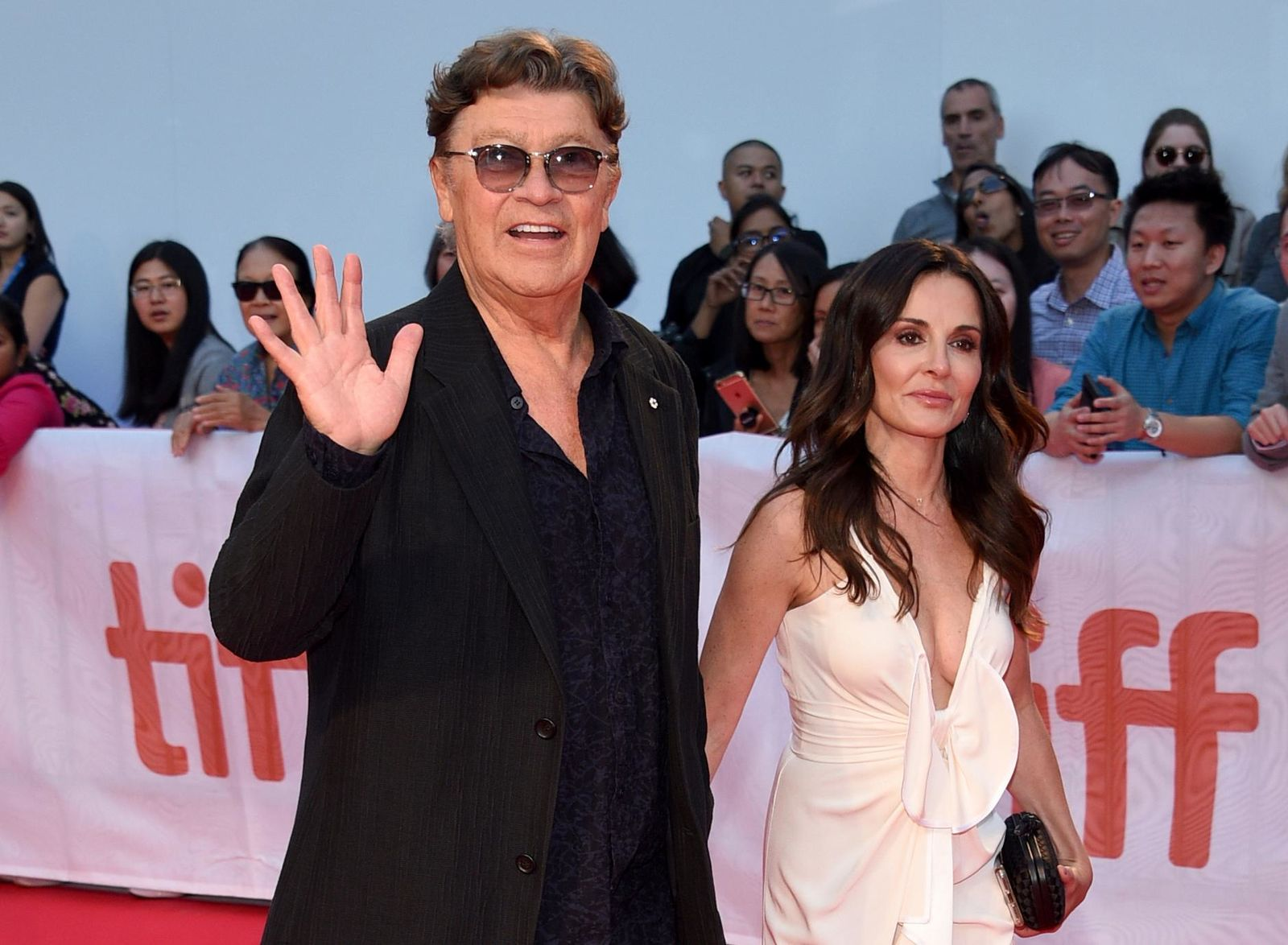 "Robbie Robertson, left, and Janet Zuccarini attend the premiere for ""Once Were Brothers: Robbie Robertson and The Band"" on day one of the Toronto International Film Festival at the Roy Thomson Hall on Thursday, Sept. 5, 2019, in Toronto. (Photo by Evan Agostini/Invision/AP)"