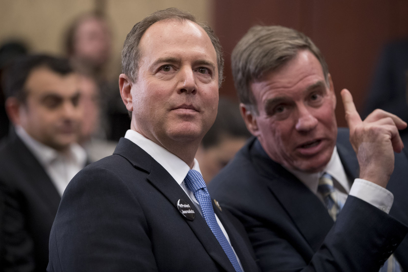 Adam Schiff, D-Calif., chairman of the House Intelligence Committee, left, speaks with Sen. Mark Warner, D-Va., at an event marking 100 days since the death of Jamal Khashoggi on Capitol Hill in Washington, Thursday, Jan. 10, 2019. (AP Photo/Andrew Harnik)