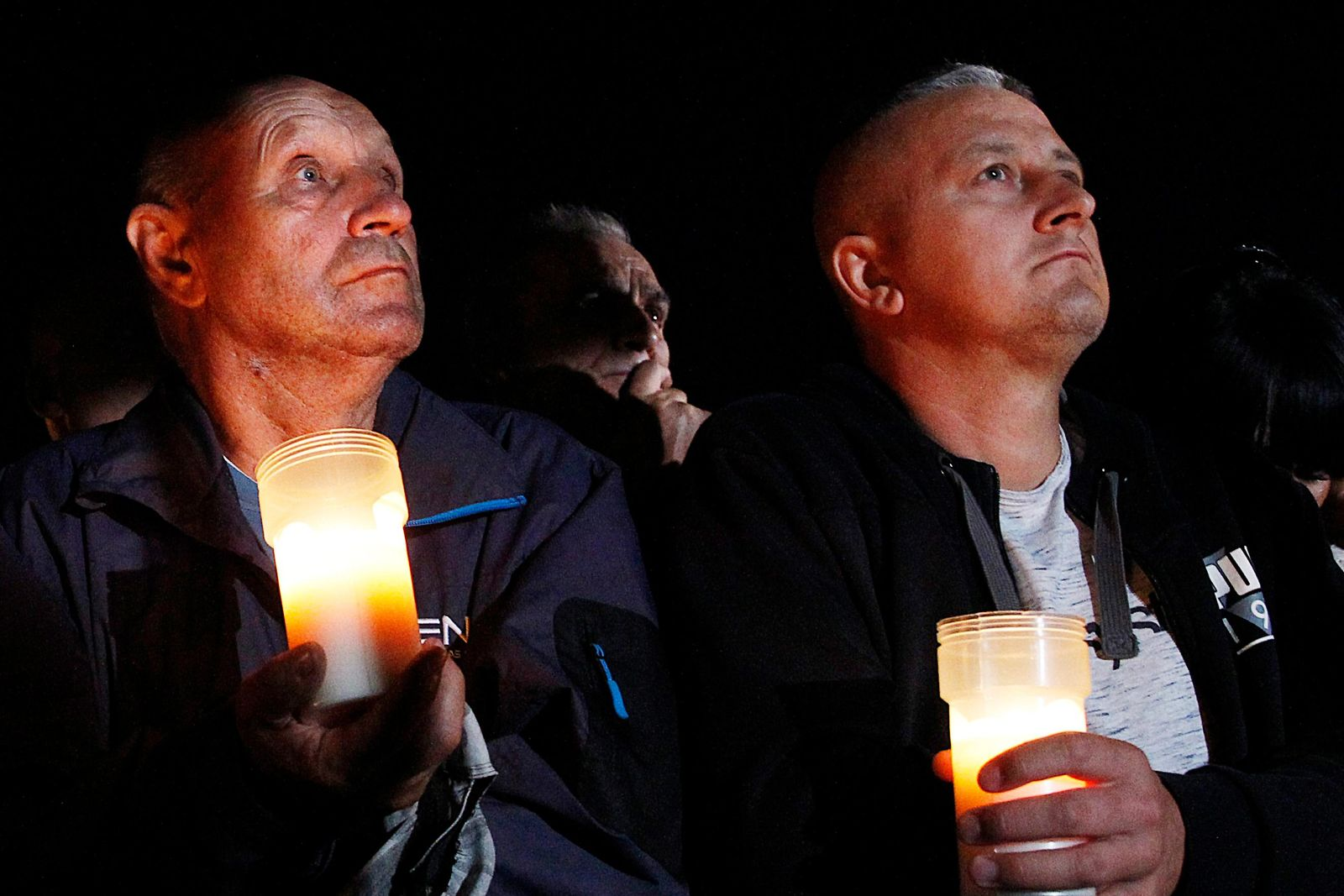 Spectators hold candles at the memorial service during a ceremony marking the 80th anniversary of the start of World War II, in Wielun, Poland, Sunday, Sept. 1, 2019. The ceremony in Wielun, attended by German President Frank-Walter Steinmeier and his Polish counterpart Andrzej Duda, started at 4.40 a.m., the exact hour that, according to survivors, the war's first bombs fell, killing civilians. (AP Photo/Czarek Sokolowski)