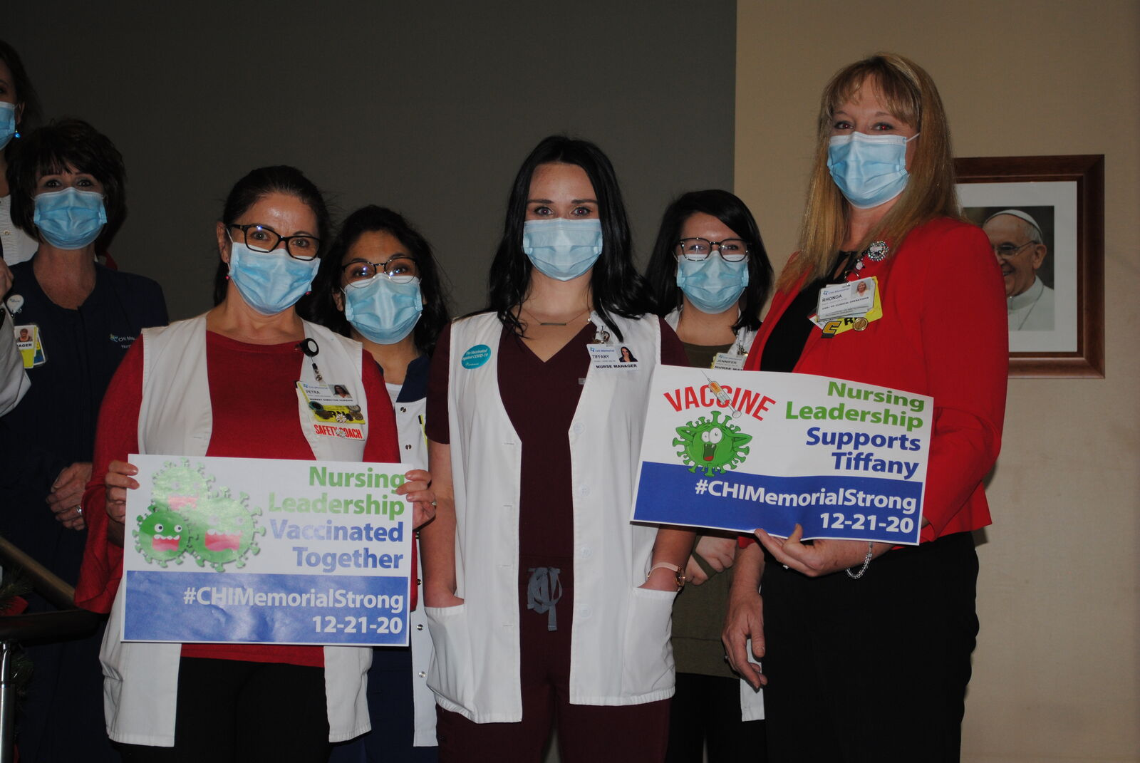 "Tiffany Dover (third from the right) is surrounded by nurses showing their support. CHI Memorial shared a video and images Monday, Dec. 21 featuring nurse Tiffany Dover, who was seen fainting shortly after taking the vaccine last week, which doctors and the CDC say can happen. CHI Memorial says that Dover is ""doing well."" (CHI Memorial image released 12/21/2020)"
