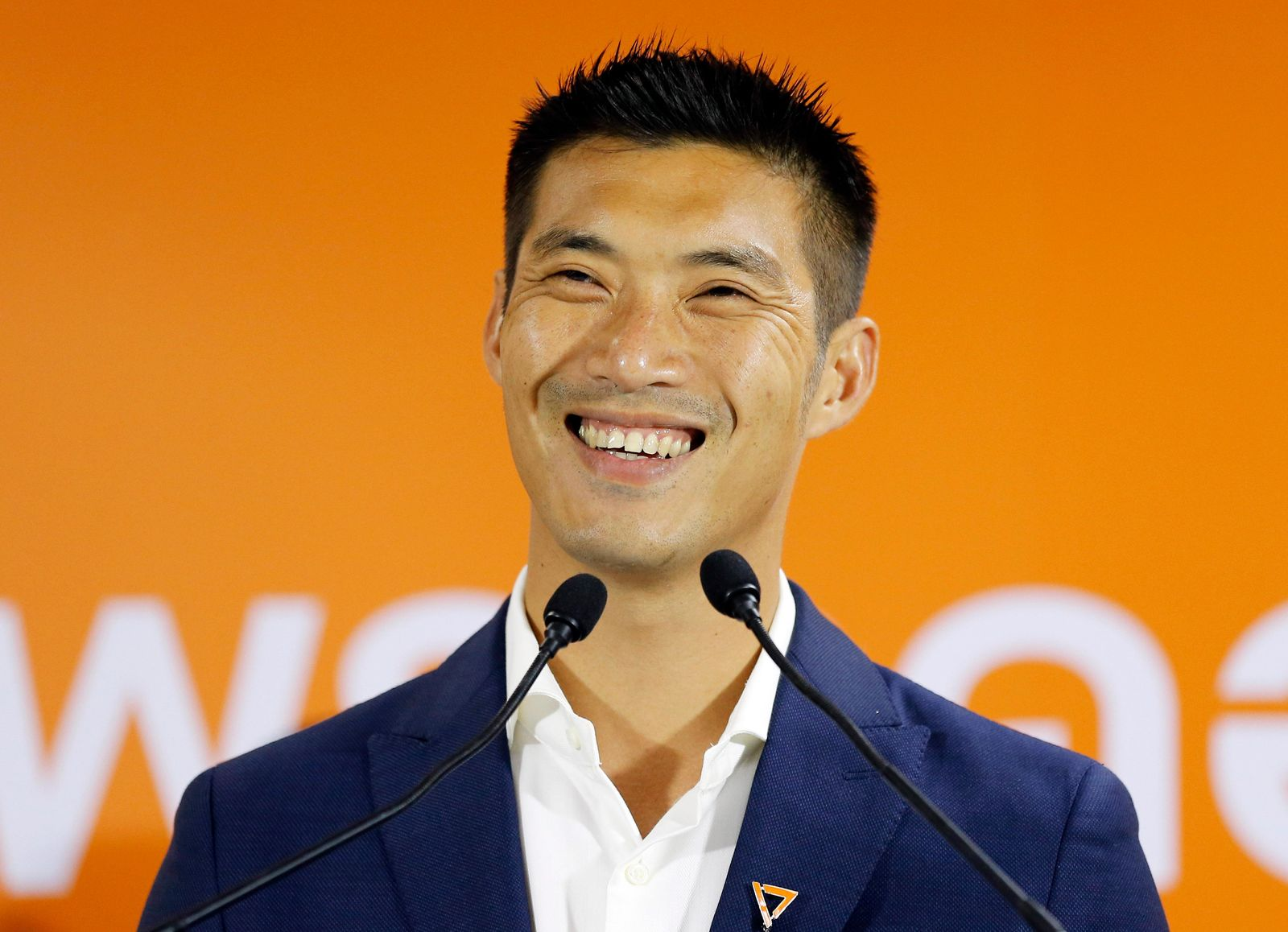 Future Forward Party leader Thanathorn Juangroongruangkit smiles during a press conference at the party headquarters in Bangkok, Thailand, Monday, March 25, 2019. The Election Commission announced the results of 350 constituency races but full vote counts, which are needed to determine the allocation of 150 other seats in the House of Representatives, won't be available until Friday. (AP Photo/Sakchai Lalit)