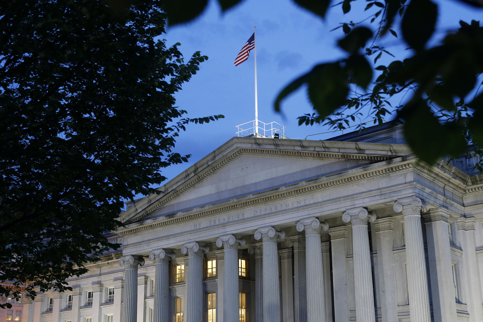 File-This Thursday, June 6, 2019, photo shows the U.S. Treasury Department building at dusk, in Washington.{ } (AP Photo/Patrick Semansky, File)