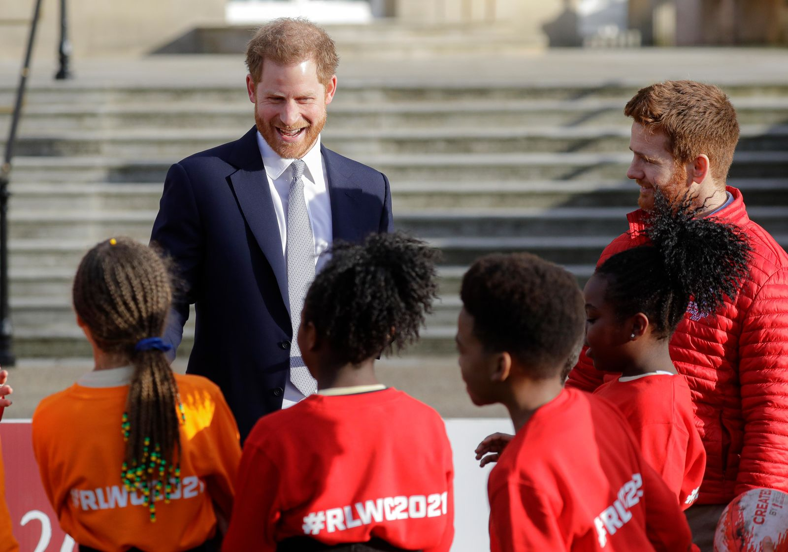 Britain's Prince Harry smiles at schoolchildren in the gardens at Buckingham Palace in London, Thursday, Jan. 16, 2020.{ } (AP Photo/Kirsty Wigglesworth)