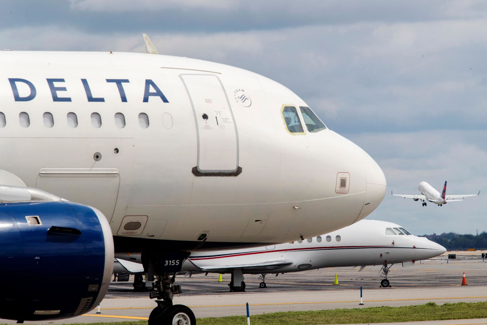 FILE - In this Aug. 8, 2017, file photo, a Delta Air Lines jet waits on the tarmac at LaGuardia Airport in New York.{ } (AP Photo/Mary Altaffer, File)