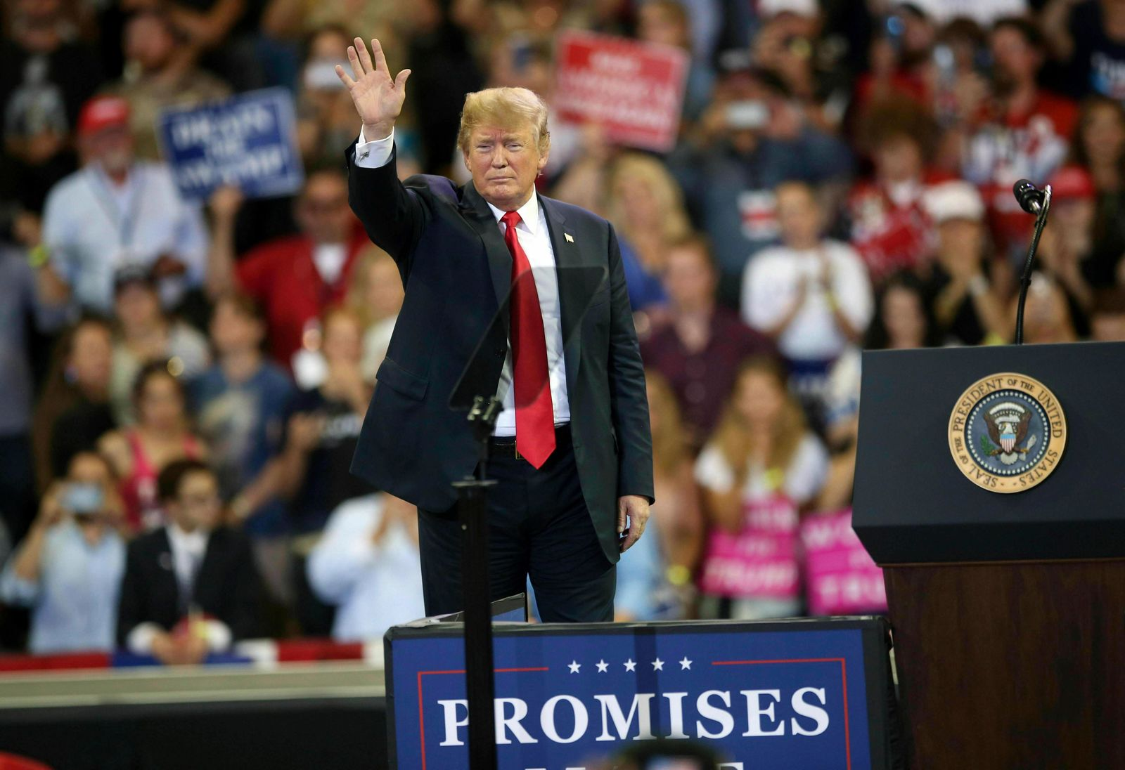 FILE - In this June 20, 2018 file photo, U.S. President Donald Trump waves to the crowd after speaking at a campaign rally, Wednesday, June 20, 2018, in Duluth, Minn. Trump heads back to Minnesota on the nation's tax filing deadline, Monday, April 15, 2019, eager to remind voters in a state he nearly carried in 2016 about the $1.5 trillion Republican tax cut. It's a policy achievement that won't resonate with everyone in Minnesota, where the loss of the state tax deduction hurt some taxpayers. And national polls show most Americans don't have a clear idea what the tax cuts did for them. (AP Photo/Jim Mone File)