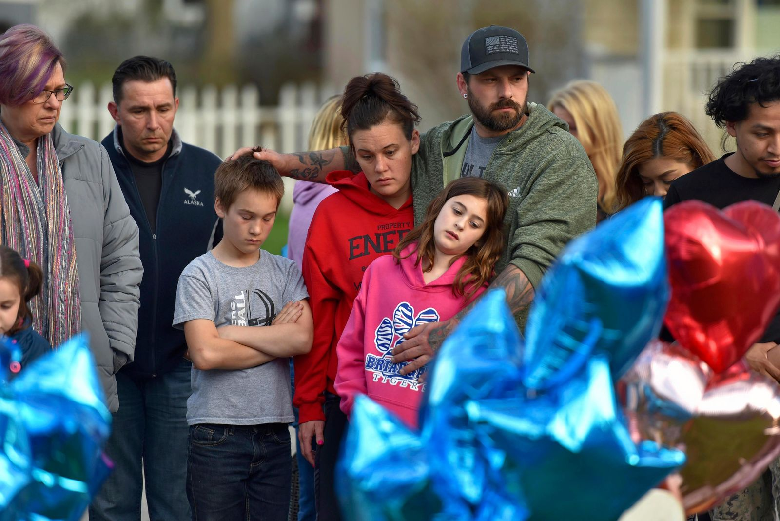 "In this Wednesday, April 24, 2019 photo, community members in Crystal lake, Ill., hold a vigil in memory of 5-year-old Andrew ""AJ"" Freund. Authorities searching for the missing Illinois boy who had lived in deplorable conditions dug up his body Wednesday and charged his parents with murder, sadly declaring that the youngster would ""no longer have to suffer.""  (John Starks/Daily Herald via AP)"