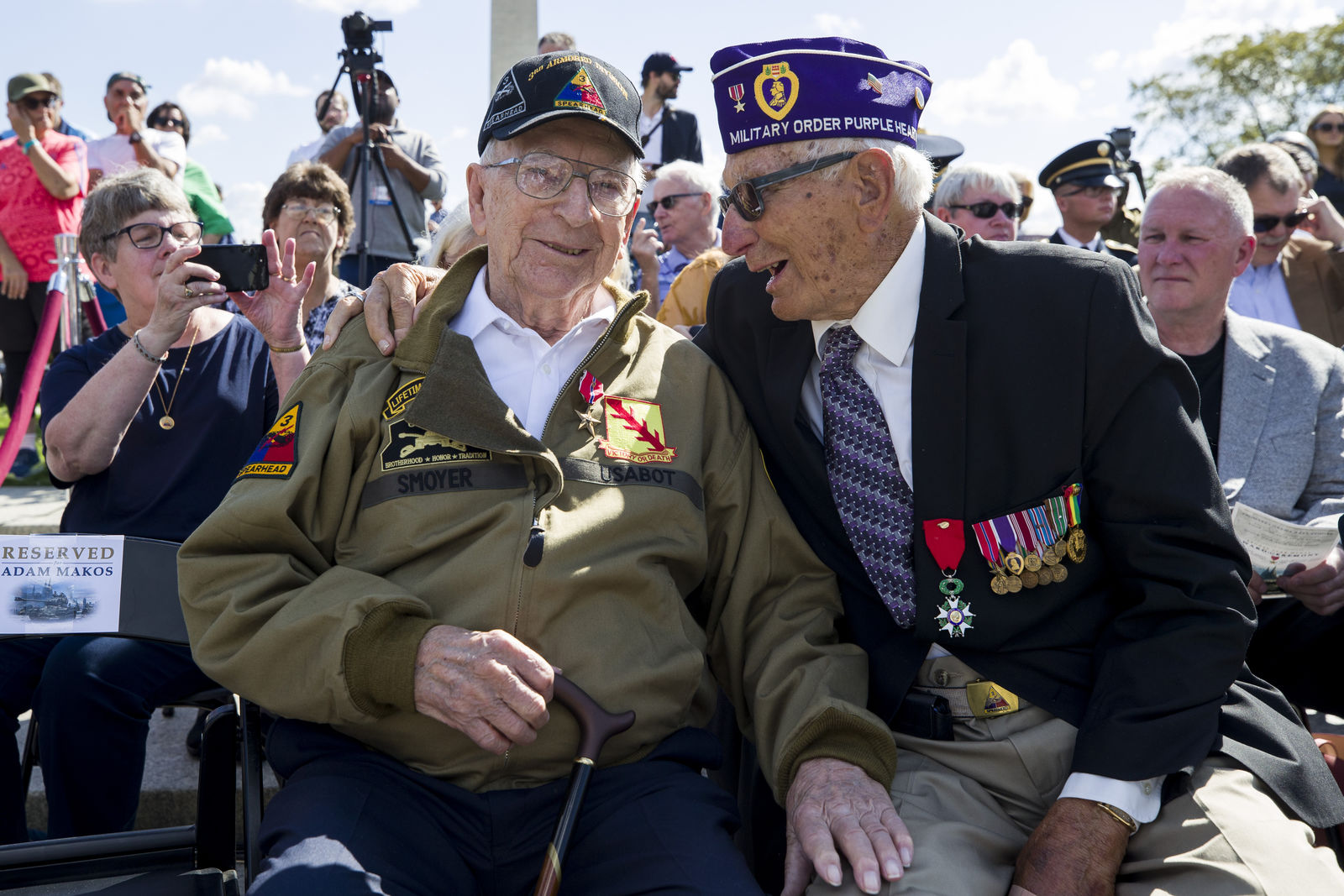 World War II veterans Clarence Smoyer, 96, left, and Joseph Caserta smile after Smoyer was presented the Bronze Star at the World War II Memorial, Wednesday, Sept. 18, 2019, in Washington. Smoyer fought with the U.S. Army's 3rd Armored Division, nicknamed the Spearhead Division. In 1945, he defeated a German Panther tank near the cathedral in Cologne, Germany — a dramatic duel filmed by an Army cameraman that was seen all over the world. (AP Photo/Alex Brandon)